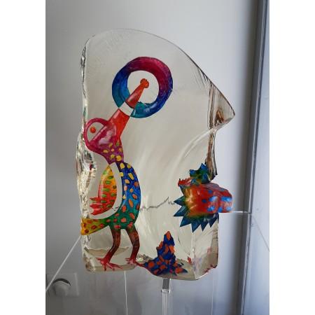 Sculpture de verre contemporain représentant un visage imaginaire aux couleurs vives vu de profil.